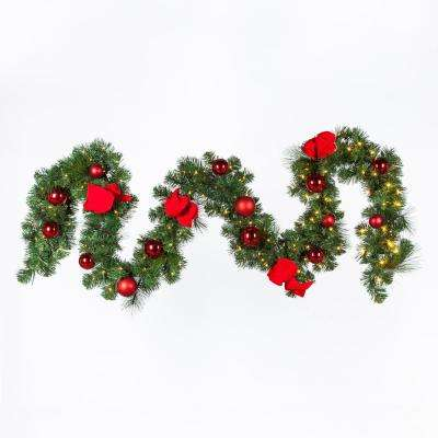 9 ft. Battery Operated Pre-Lit LED Artificial Christmas Garland with Ornaments and a Velvet Bow