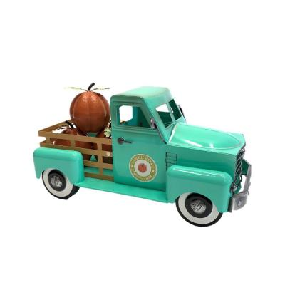 10 in. Tall Country Style Metal Truck with Pumpkins in Antique Teal