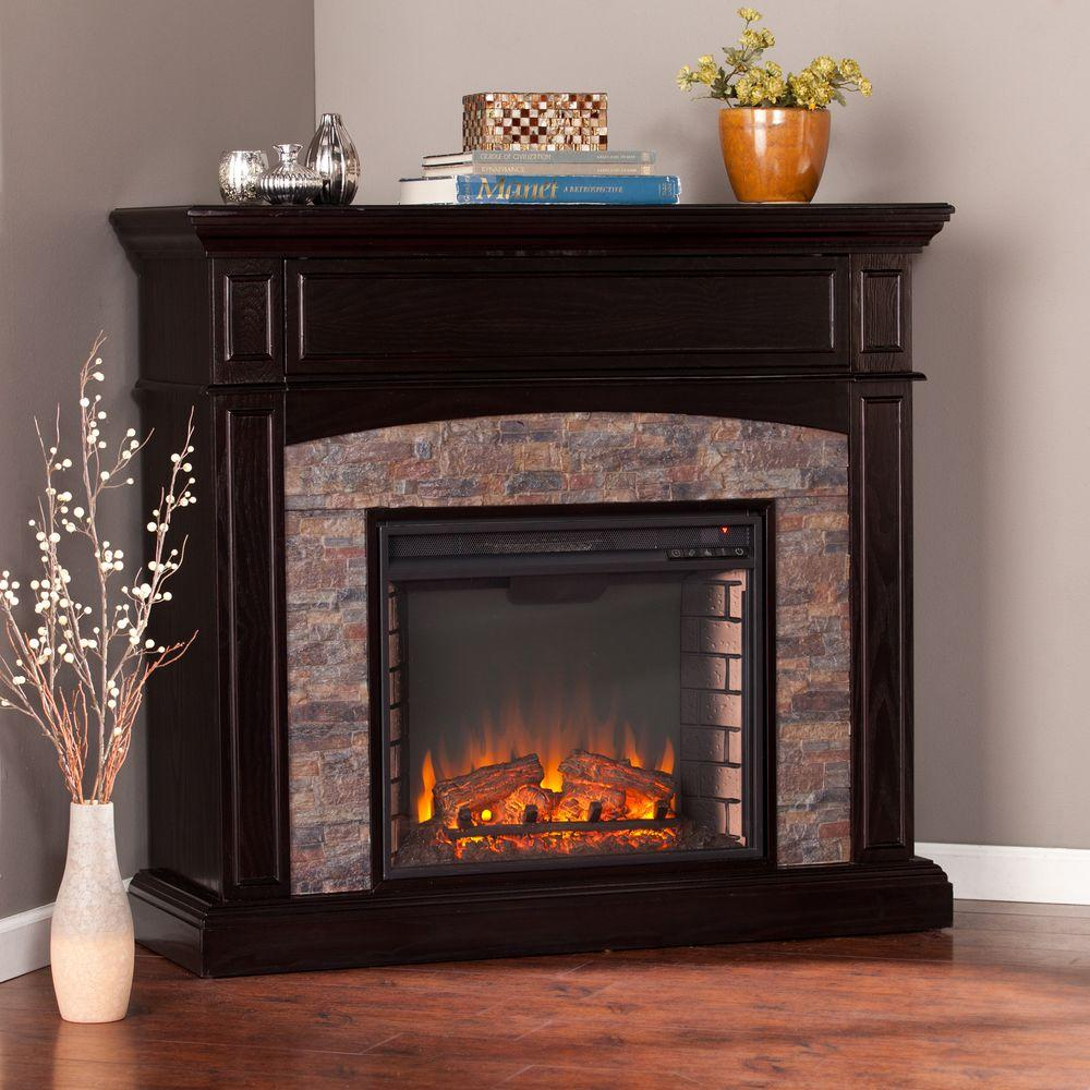 Provide a convenient update for your home by using Southern Enterprises Newburgh Faux Stone Corner Electric Media Fireplace in Ebony.