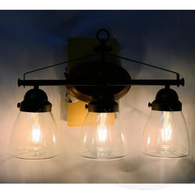 3-Light Brown Vanity Light with Clear Seedy Glass Shade