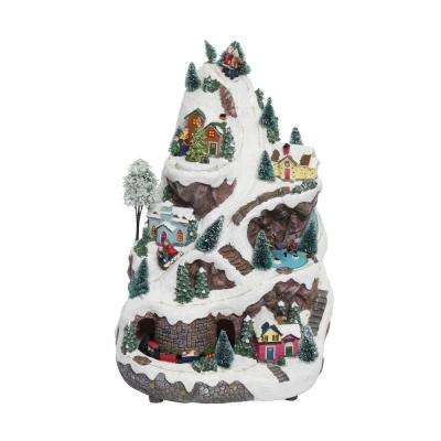 Alpine 18 in. Tall Christmas Village Turning Train, Skaters and Music with 75-Warm LED Lights