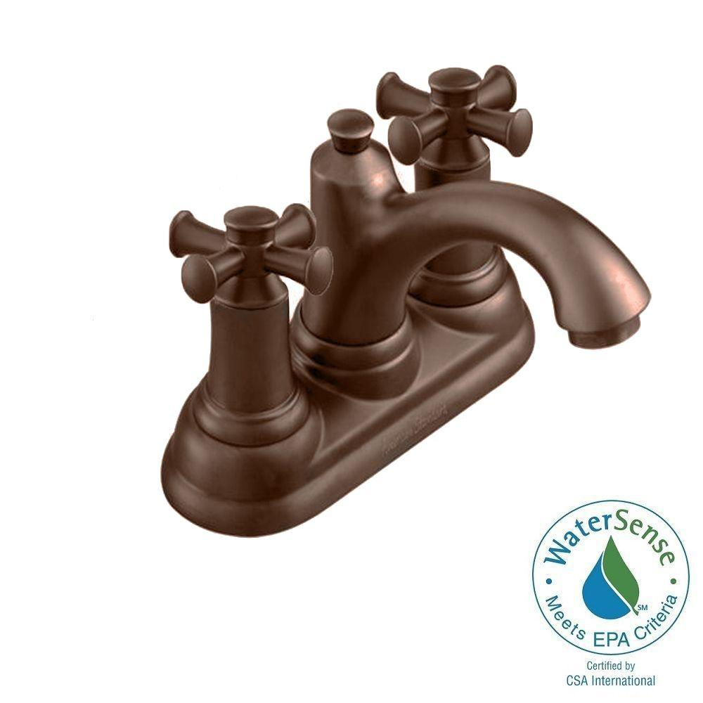Portsmouth Single Hole 2-Handle Mid-Arc Bathroom Faucet in Oil Rubbed Bronze