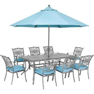 Traditions 9-Piece Aluminum Outdoor Dining Set with Blue Cushions, 8 Chairs, Cast-Top Table and Umbrella with Stand