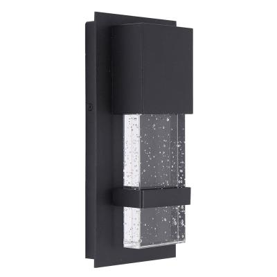 Venecia 4.75 in. W x 10 in. H Matte Black Outdoor Integrated LED Wall Lantern Sconce with Clear Seeded Glass