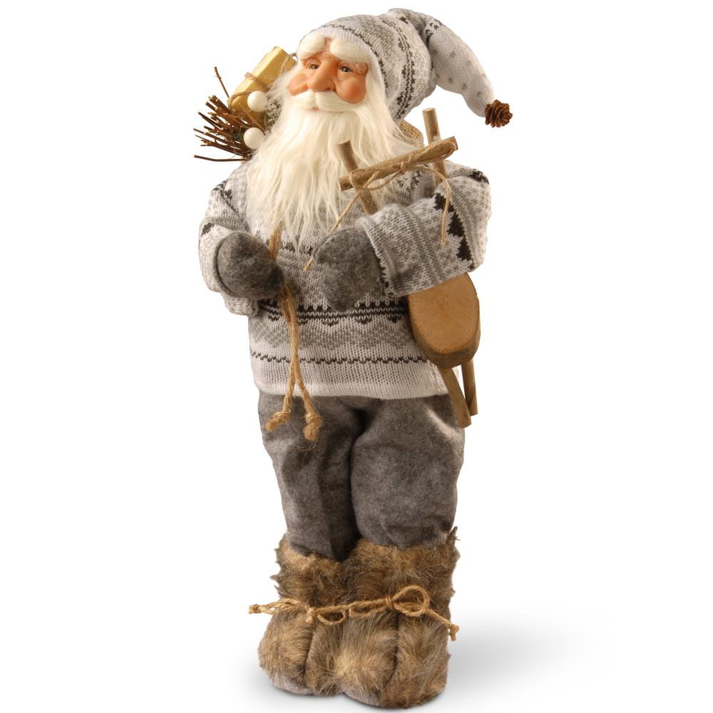 National Tree Company 17.7 in. Standing Santa This Santa figure will add a taste of whimsy to your holiday decorating theme. Santa is wearing an ornately patterned sweater with matching stocking cap. Over his shoulder he carries a sack of greens and gifts. Fluffy laced boots complete the ensemble.