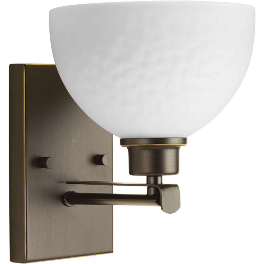 Legend Collection 1-Light Antique Bronze Bath Sconce with Sculpted Glass Shade
