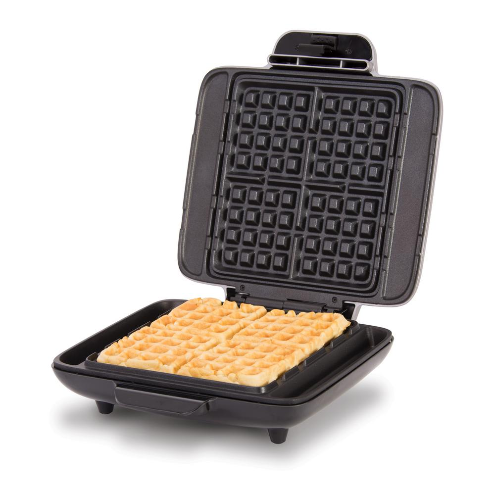 Dash No Mess Waffle Maker in Silver Prepare up to 4 warm, golden waffles at a time without the sticky surfaces and dripping edges. The Dash No Mess Waffle Maker heats evenly, making 4 perfectly cooked square waffles every time. PFOA-free nonstick cooking surfaces make the No Mess Waffle Maker easy to clean, while the overflow channel prevents batter from spilling out of the sides and onto your countertops. Make savory waffles, hash browns, classic waffles, and dessert waffles with this versatile waffle maker. Color: Silver.