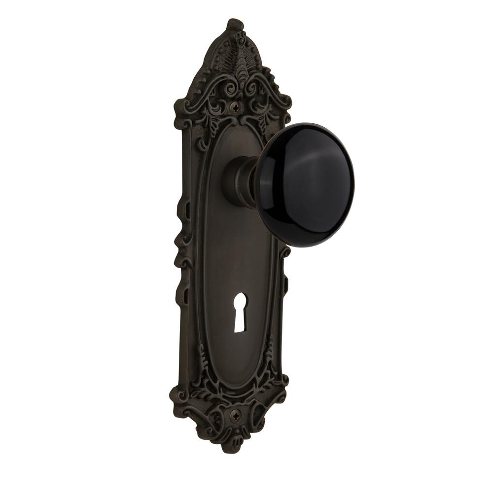 Nostalgic Warehouse Victorian Plate with Keyhole 2-3/4 in. Backset Oil-Rubbed Bronze Passage Hall/Closet Black Porcelain Door Knob