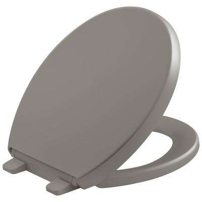 Reveal Quiet-Close Round Closed Front Toilet Seat with Grip-tight Bumpers in Cashmere