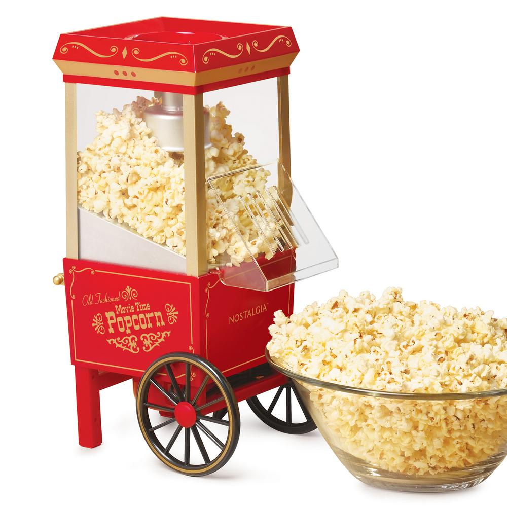 Vintage Hot Air Popcorn Maker, Red The Nostalgia OFP501 Vintage Collection 12-cup Hot Air Popcorn Maker is a replica of the old-fashioned, street-corner popcorn stands of the early 1900s and is a table-top sized party pleaser. In just minutes, family and friends can enjoy the taste of freshly popped popcorn! Its electric popping system uses hot air instead of oil, producing a light and healthy snack. This popcorn maker comes with a measuring cap that assures the proper amount of kernels are used in each batch. Enjoy the fresh taste of hot popcorn in minutes! Color: Red.