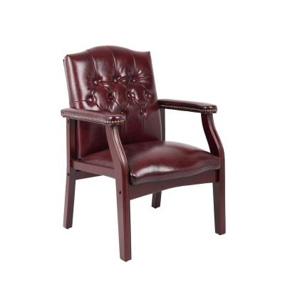 Traditional Side Chair. Burgundy Vinyl. Mahogany Finish. Button Tufted Cushion Design. Brass Nail Heads.