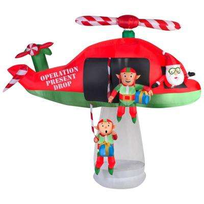 114.17 in. D x 57.09 in. W x 96.85 in. H Animated Inflatable Santa and Elves in Helicopter Scene