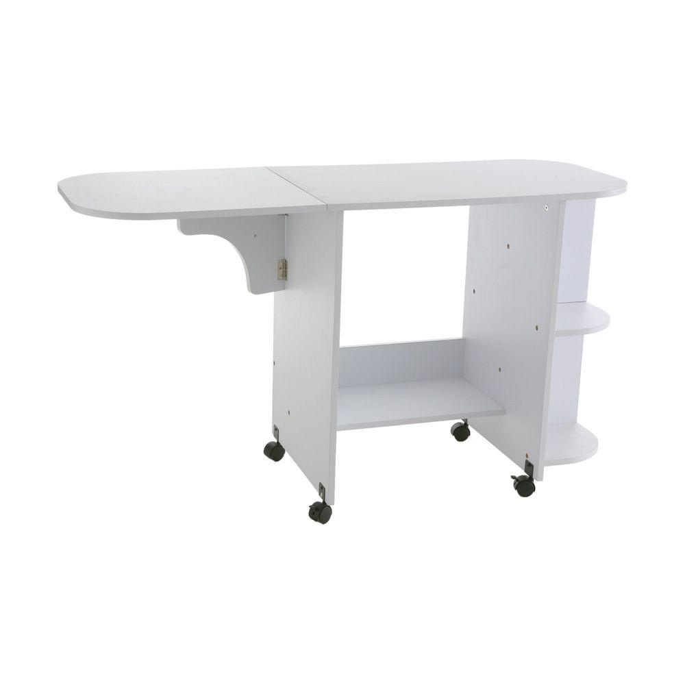 Sei White Sewing Table, Painted White The White Sewing Table from Home Decorators Collection provides all the sewing space you need in one compact piece. The generous extended table gives you plenty of work area and conveniently folds down for easy storage, while the 3 fixed shelves provide ample space for sewing accessories. Durable with middle-density fiberboard (MDF) and melamine paper construction with a white laminate finish, this sewing table is built-to-last and is easily portable with the attached casters. Color: Painted White.
