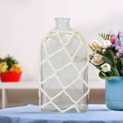 4 in. x 8 in. Clear Glass Bottle with Woven Rope Cage