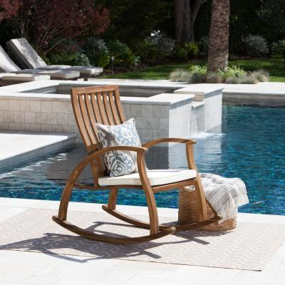Travis Natural Stained Wood Outdoor Rocking Chair with Cream Cushion