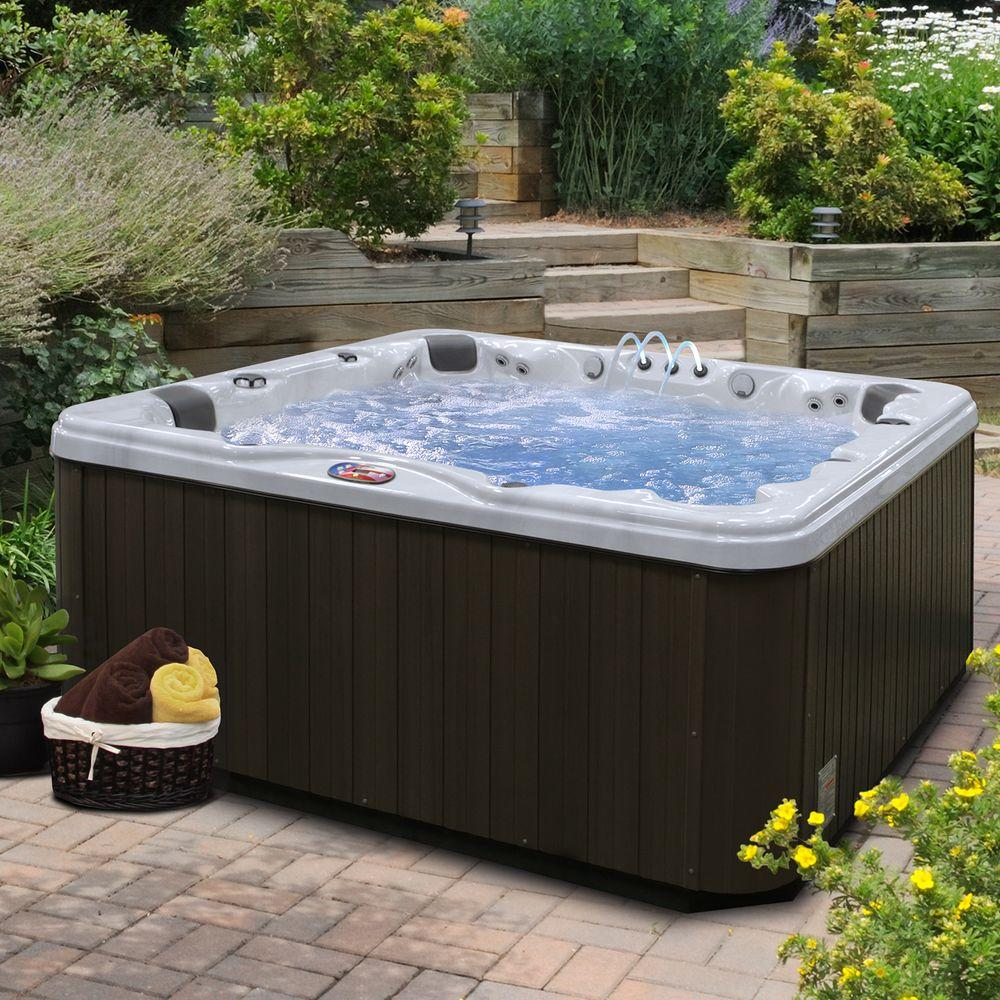 American Spas 7-Person 56-Jet Premium Acrylic Lounger Spa Hot Tub with Bluetooth Stereo System, Subwoofer and Backlit LED Waterfall