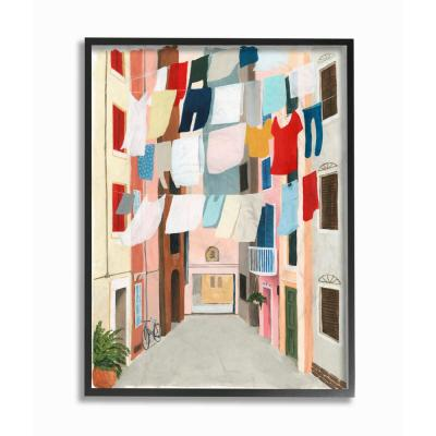 """24 in. x 30 in. """"Colorful Laundry Day Clothes Line Between Apartments"""" by Grace Popp Framed Wall Art"""