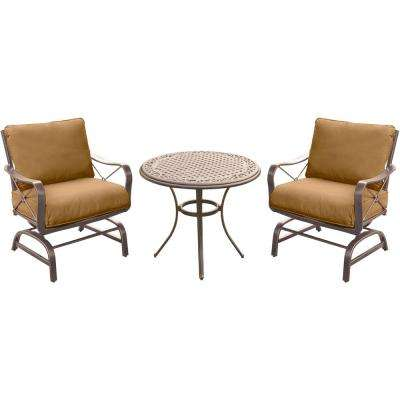Summer Nights 3-Piece Outdoor Bistro Set with Steel Rockers and Round Cast-Top Table with Desert Sunset Cushions
