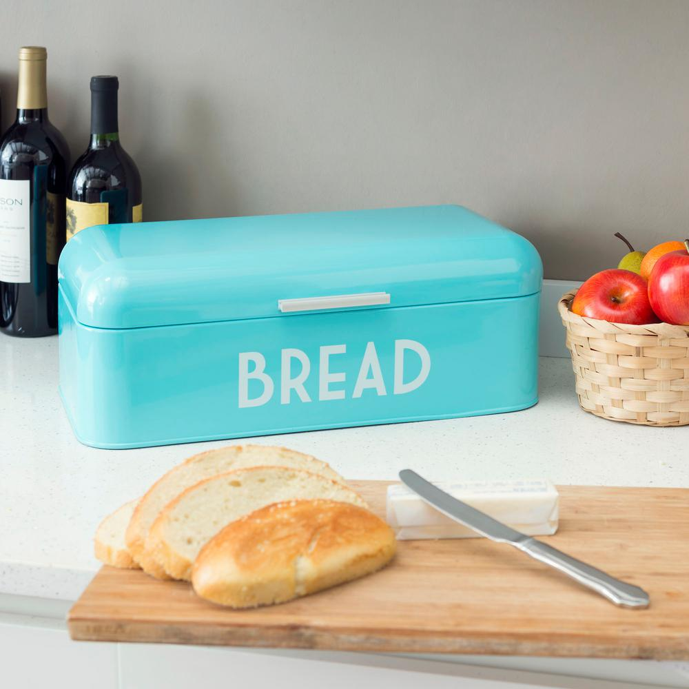 Home Basics Turquiose Bread Box Conveniently store baked goods and fresh bread neatly in this HOME basics Bread Box. Made from durable powder coated steel, the words  Bread  are printed atop a enchanting turquoise hue. With a roll up lid and sturdy handle, putting away and grabbing a loaf of bread or baked snack is a snap. Color: Turquiose.