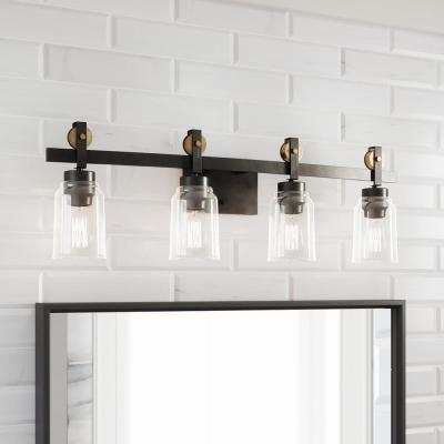 Knollwood 4-Light Antique Bronze Vanity Light with Vintage Brass Accents and Clear Glass Shades