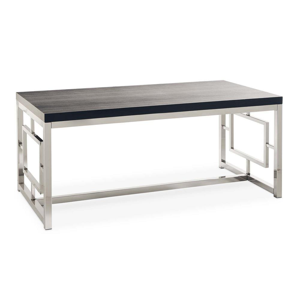 Picket House Furnishings Harper Black/Chrome coffee Table, Chrom The Picket House Furnishings Harper Coffee Table is modern glam at its best. This rectangle coffee table will look super chic in your living space. The coffee table features a black table top that pairs beautifully with the chrome finish and will pair with any existing decor or furnishings you already have. The sides of the coffee table feature an intricate design adding extra flair to this already stylish table. Adding this living room staple to your home will instantly add style and glam, a look you'll never get tired of. Color: Chrom.
