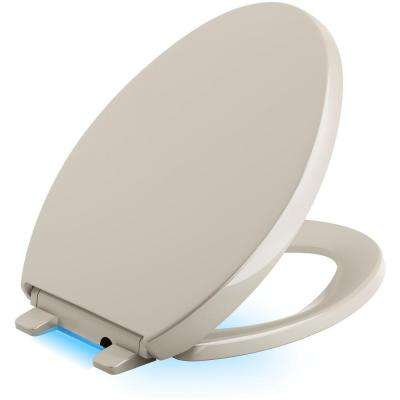 Reveal LED Nightlight Elongated Closed Front Toilet Seat in Sandbar