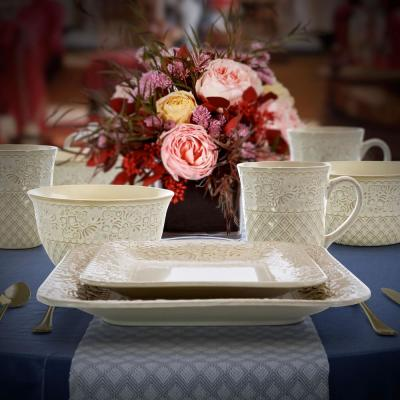 Ivory Lotus 16-Piece Traditional White Stoneware Dinnerware Set (Service for 4)