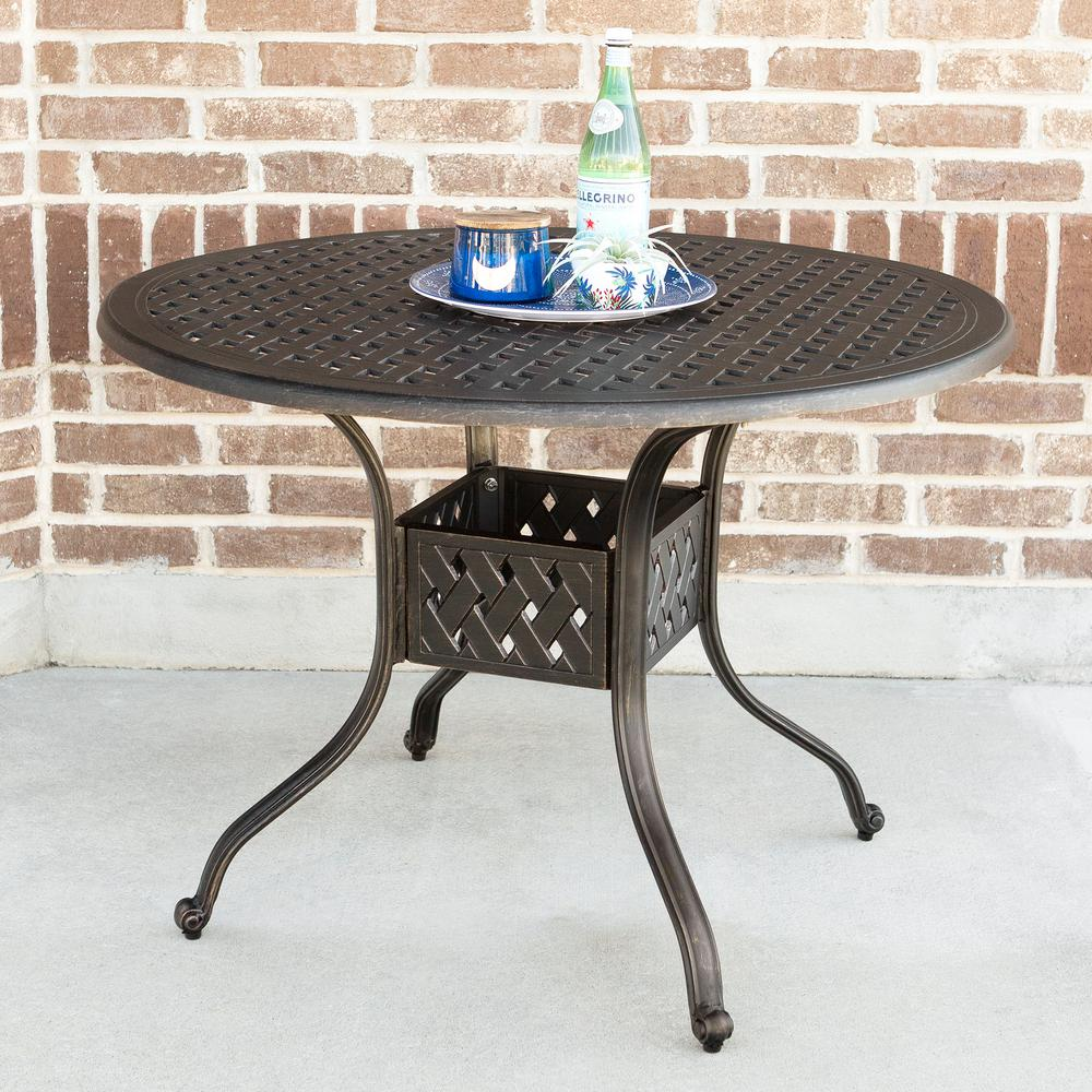 Walker edison furniture company 42 in round cast aluminum patio dining table in antique bronze