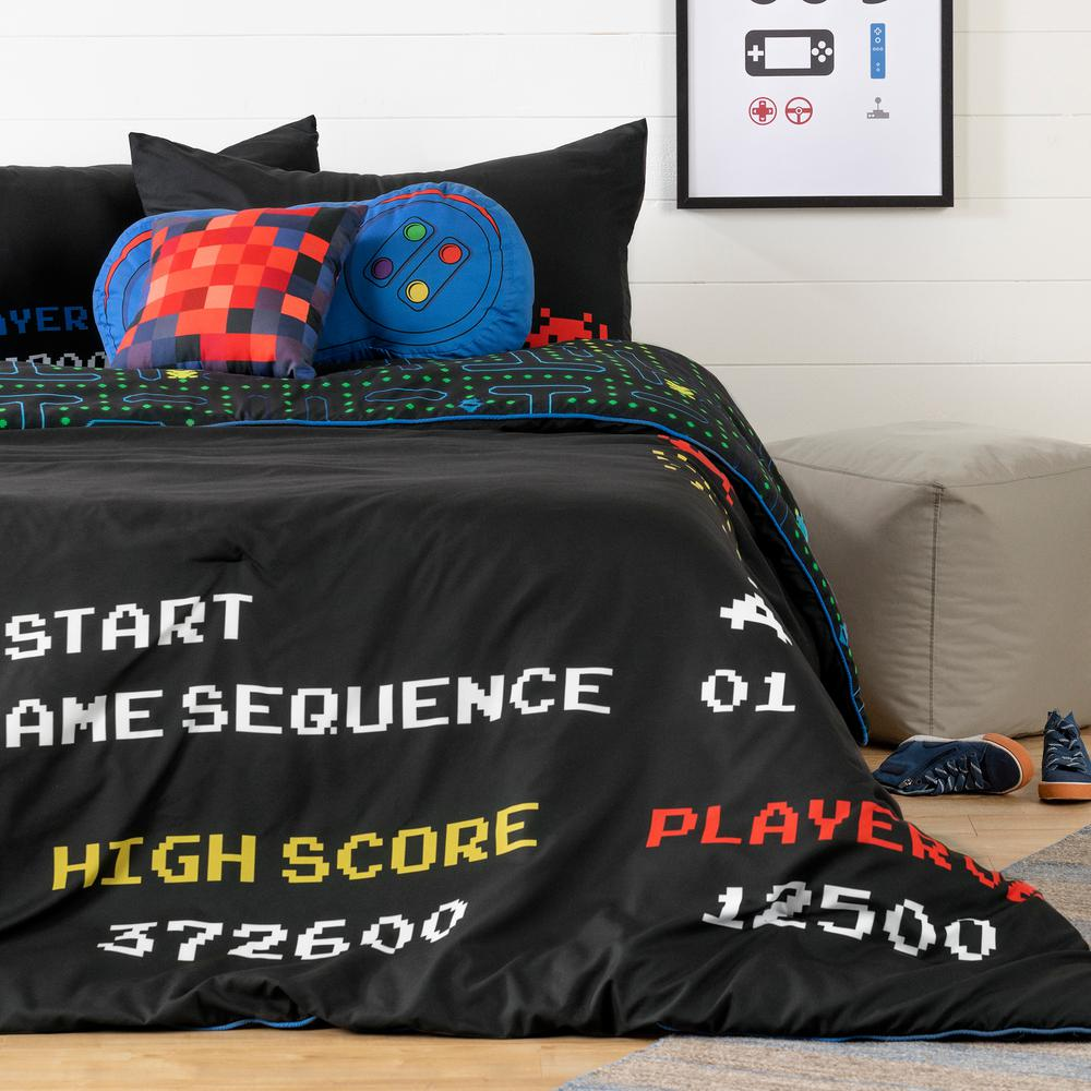 DreamIt 5-Piece Black Video Game Full Bedding Set Reversible Video Game Theme -Enter the virtual universe of the famous PAC Man game a classic from back in the day thats become trendy once again. Real video game buffs will love this reversible bedding set. Boys and girls, both young and young at heart, can adapt the fun retro style to create a modern ambiance. The reversible comforter gives them two choices: the printed maze scattered with ghosts and PAC-gums, or the solid black side featuring the colorful graphics of those old game consoles. All Inclusive. This bedding set includes more than the reversible comforter: you also get two pillowcases and two themed pillows. Coordinate the vintage blue video game joystick with the square pillow imprinted with a matching red pixelated ghost and there you have it the perfect set for your teens. Easy Care -Make laundry easier for your kids with this machine washable bedding set. The comforter and its accessories should be washed separately from other items, then air dry them or pop them in the dryer.