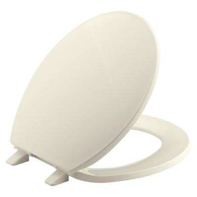 Brevia Round Closed Front Toilet Seat with Quick-Release Hinges in Almond