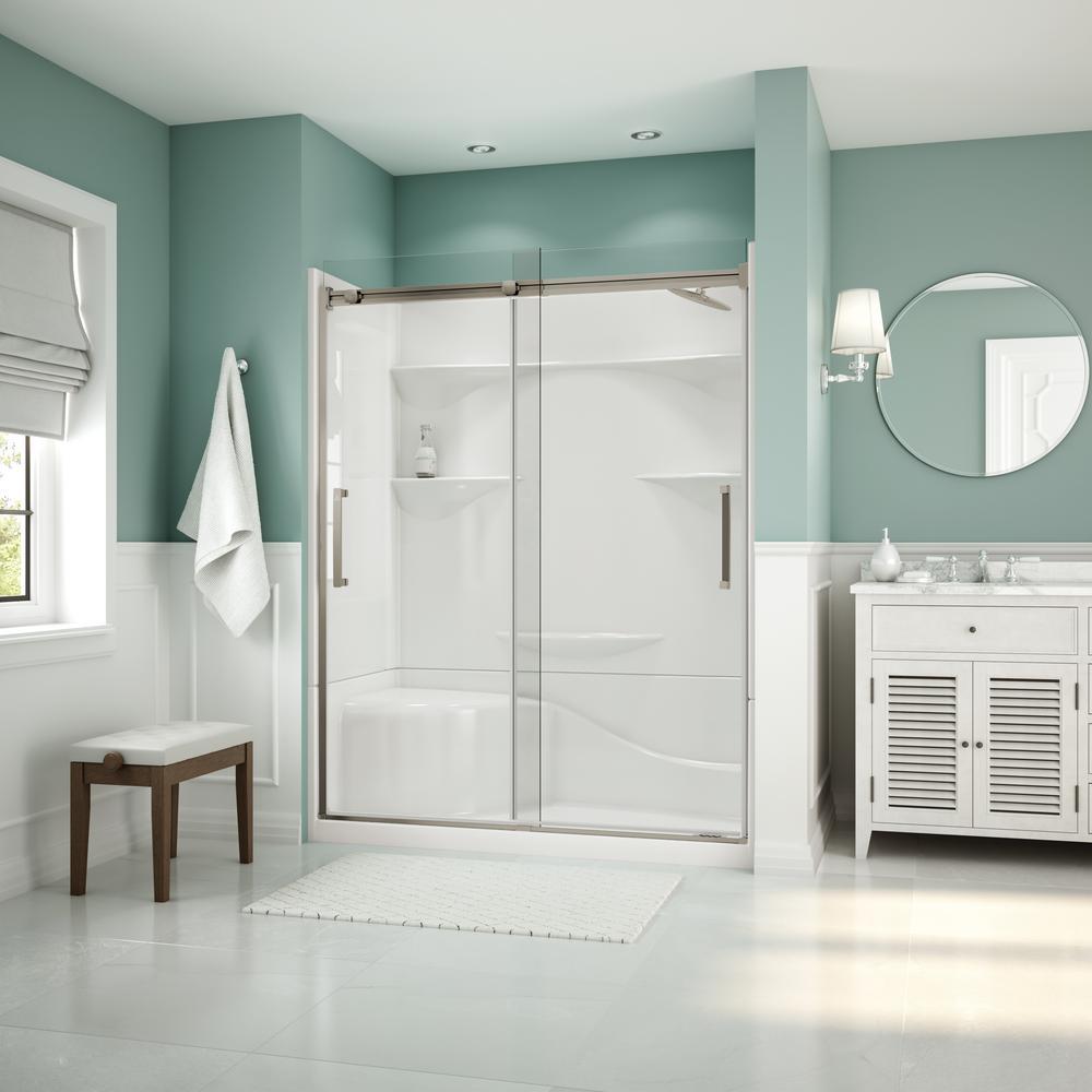 Frameless sliding glass shower door in brushed
