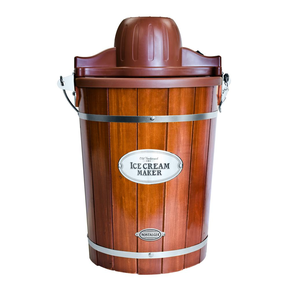 6 Qt. Ice Cream Maker, Brown The Nostalgia ICMP600WD Vintage Collection 6 Qt. Wood Bucket Electric Ice Cream Maker with Easy-Clean Liner is a fast and easy way to make 6 Qt. of ice cream, frozen yogurt, or gelato. Featuring a locking motor mount, easy to clean plastic bucket and 6 Qt. aluminum canister. Simply add your ingredients into the aluminum canister and place in the middle of the bucket, layer with ice and salt and let the electric motor do the rest. The durable churn paddle produces delicious creamy homemade ice cream and the easy clean liner makes for easy clean up. Customize each recipe by adding extras, like strawberry preserves, cookie dough, candy pieces and more. When done, use the included lid and lid cap to store leftover ice cream in the freezer. Color: Brown.