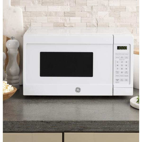 Ge 0 7 Cu Ft Small Countertop Microwave In White Jes1072dmww The Home Depot
