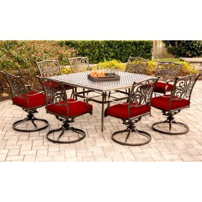 Traditions 9-Piece Aluminum Outdoor Dining Set with Swivel Rockers with Red Cushions