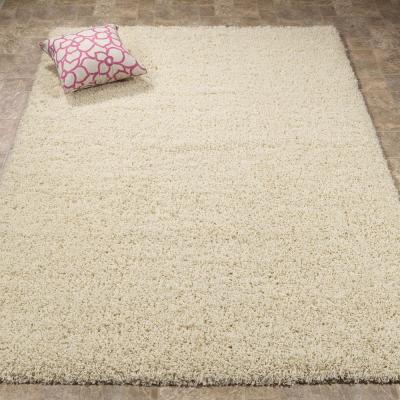 Plush Solid Shaggy Beige 8 ft. x 10 ft. Shag Area Rug