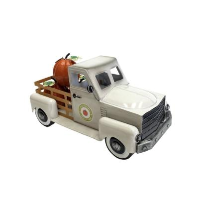 10 in. Tall Country Style Metal Truck with Pumpkins in Antique White