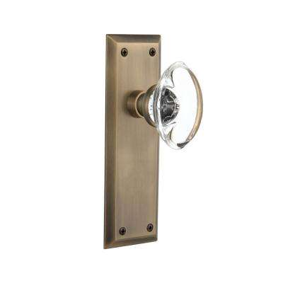 New York Plate 2-3/8 in. Backset Antique Brass Privacy Bed/Bath Oval Clear Crystal Glass Door Knob