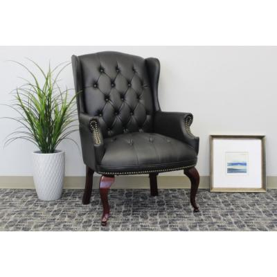 Wing Back Chair. Black Vinyl. Mahogany Finish. ButtonTufted. Brass Nail Heads