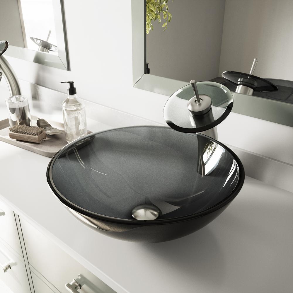 Glass Vessel Sink in Sheer Black with Waterfall Faucet Set in Brushed Nickel