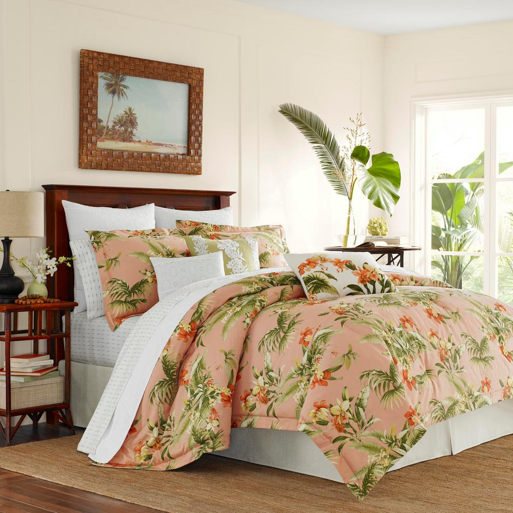 Siesta Key 3-Piece King Duvet Cover Set, Pink Create an island oasis no matter where you call home with this all cotton, sun-drenched botanical print from Tommy Bahama. Tropical leaves and wild orchids in a refreshing palette of warm corals, pale yellow and leafy greens are set against a rosy background of coral pink, lending the luminous glow of a tropical sunset. A white cotton eyelet accent pillow and European shams add a romantic, feminine touch and additional decorative pillows with pineapple and floral embroidery enhance the island mood. Layer in our Pineapple Stripe cotton sheet set to complete the look. Full/Queen Duvet Cover Set includes: One full/queen duvet cover (92 in. L x 88 in. W) and two standard shams (21 in. L x 27 in. W), King Duvet Cover Set includes: One king duvet cover (92 in. L x 107 in. W) and two king shams (21 in. L x 37 in. W).