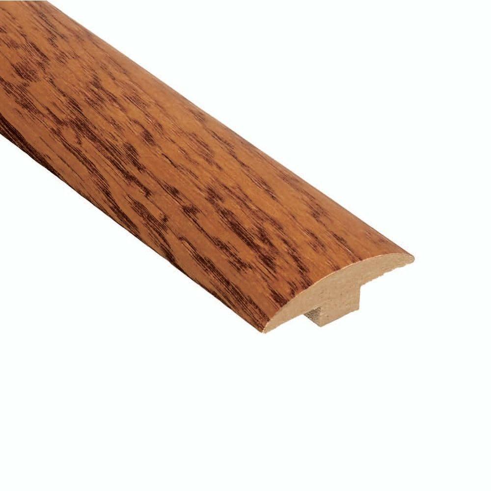 Home Legend Oak Gunstock 3/8 in. Thick x 2 in. Wide x 78 in. Length Hardwood T-Molding