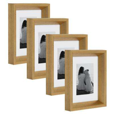 Calter 5 in. x 7 in. Matted to 3.5 in. x 5 in. Gold Picture Frame (Set of 4)
