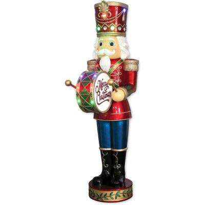 5 ft. Christmas Nutcracker Playing Bass Drum with Moving Hands, Music, Timer, and 15 LED Lights