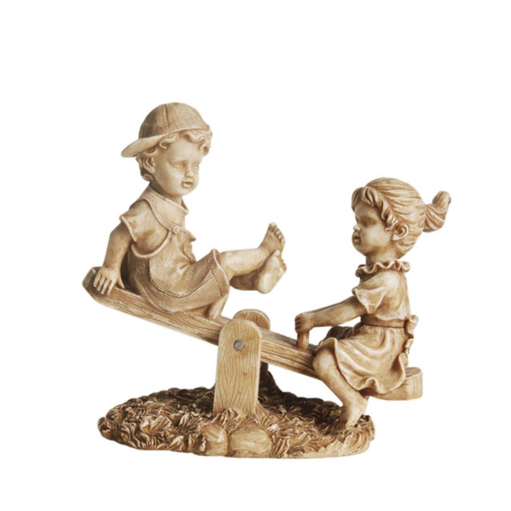 Boy And Girl Playing On Seesaw Statue