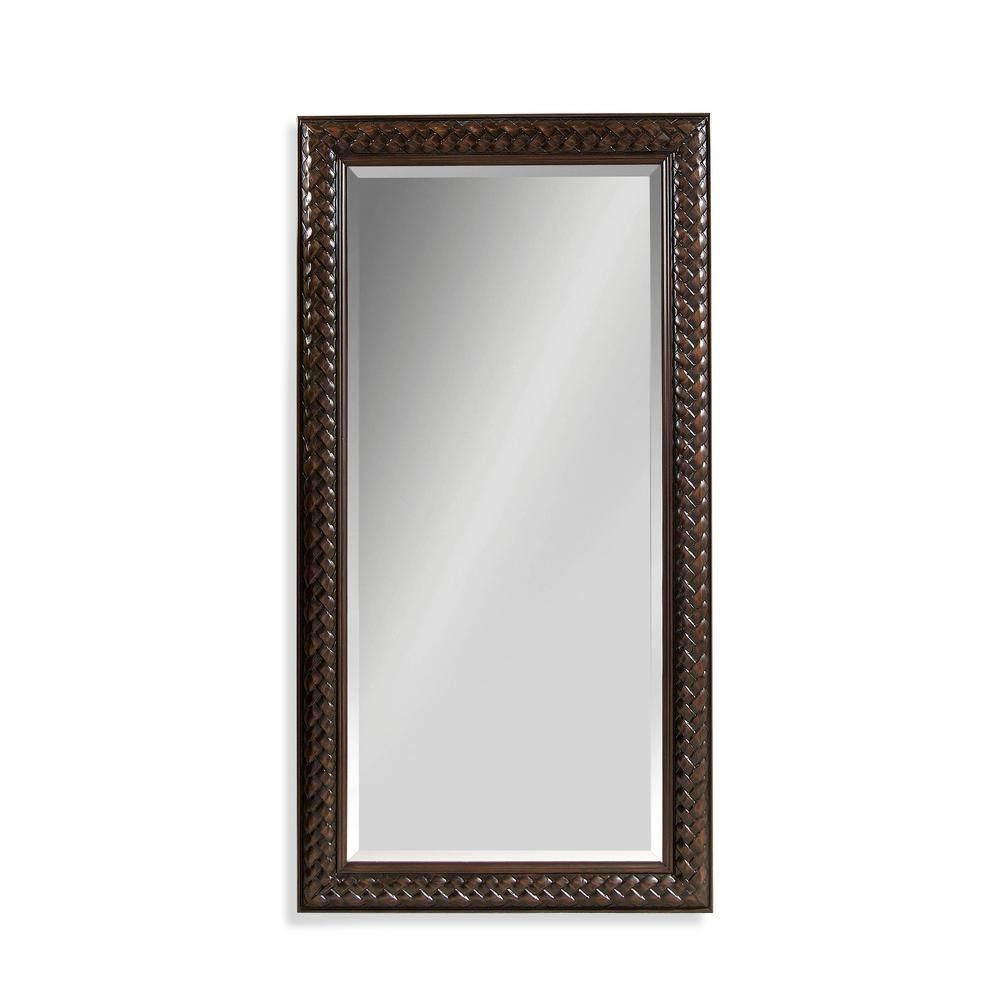 BASSETT MIRROR COMPANY Newcombe Leaner Decorative Mirror Our Newcombe leaner mirror will open up your room, adding dimension and style. Crafted of fruitwood with a deep cherry finish. This mirror's beautifully braided frame makes an engaging statement in your home.