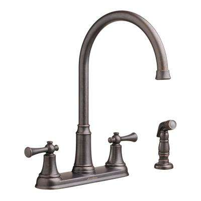 Portsmouth 2-Handle Standard Kitchen Faucet with Side Sprayer in Oil Rubbed Bronze