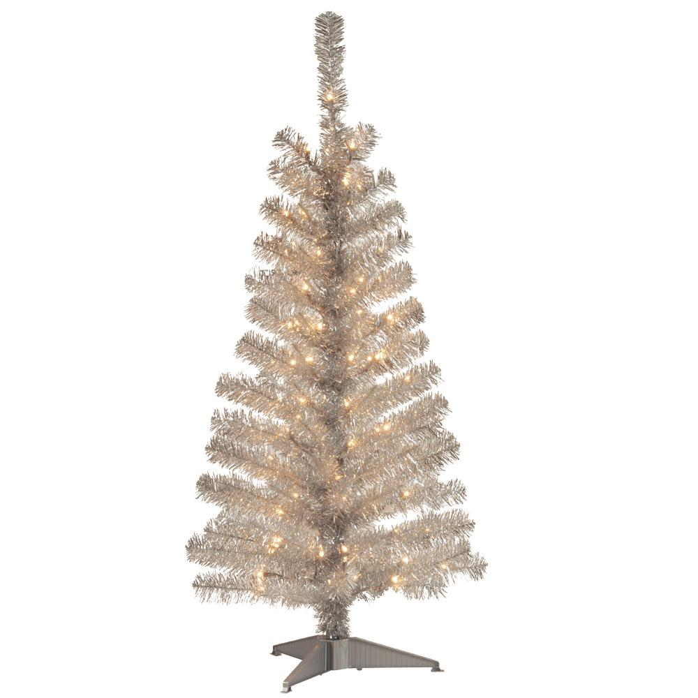 silver tinsel artificial christmas tree with clear lights