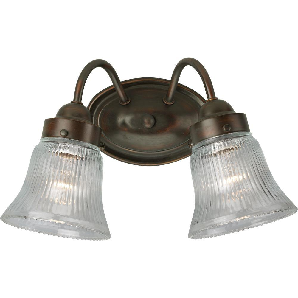 Progress Lighting Fluted Glass Collection 2-Light Antique Bronze Vanity Light with Clear Polished Glass Shades