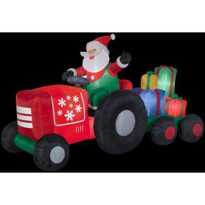 8.5 ft. W x 4.5 ft. H Inflatable Santa on Tractor with Presents Scene