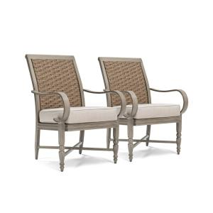 Click here to buy BLUE OAK Saylor Wicker Outdoor Dining Arm Chair with Outdura Remy Sand Cushion (2-Pack) by BLUE OAK.